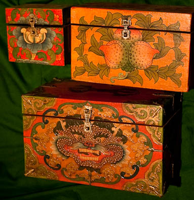 Small polychrome wooden chests in three sizes and different models